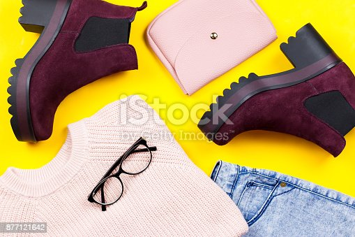 istock Autumn female clothing - pink sweater, blue jeans, leather handbag, chunky ankle boots, accessories 877121642