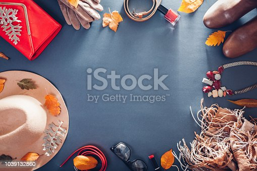 840310962istockphoto Autumn female outfit. Set of beige and red clothes, shoes, cosmetics and accessories. Copy space 1039132860