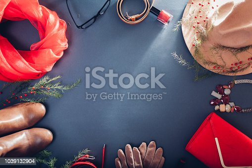 840310962istockphoto Autumn female outfit. Set of beige and red clothes, shoes, cosmetics and accessories. Copy space 1039132904