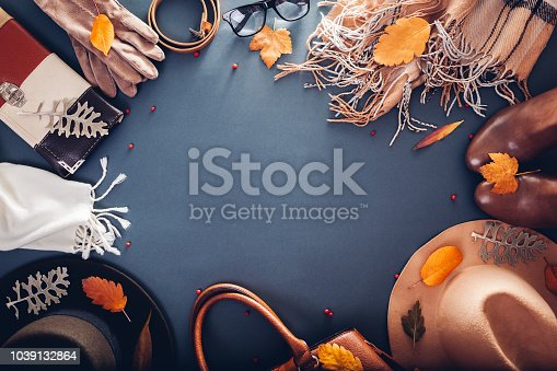 840310962istockphoto Autumn female outfit. Set of clothes, shoes and accessories. Copy space. Shopping concept 1039132864