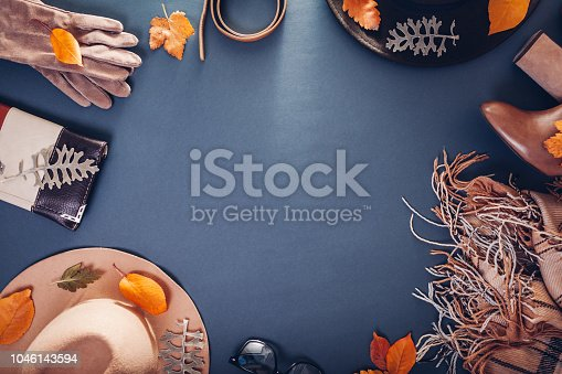 840310962istockphoto Autumn female outfit. Set of clothes, shoes and accessories. Copy space. Shopping concept 1046143594