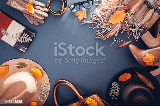 840310962istockphoto Autumn female outfit. Set of clothes, shoes and accessories. Copy space. Shopping concept 1046143596