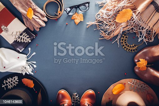 840310962istockphoto Autumn female outfit. Set of clothes, shoes and accessories. Copy space. Shopping concept 1046143600