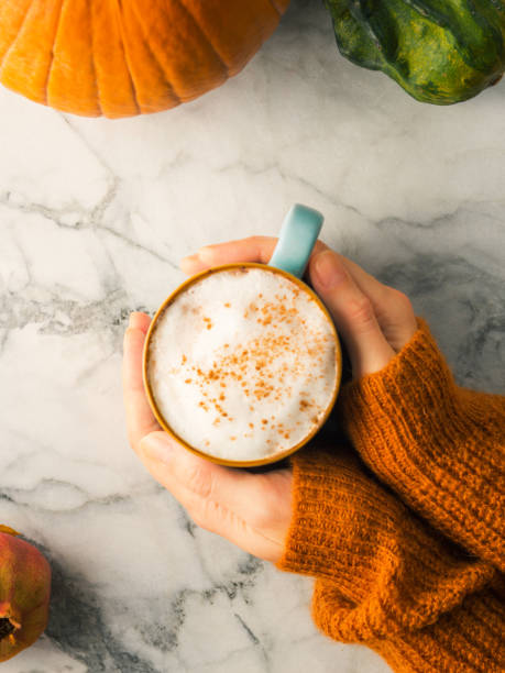 Autumn flat lay with mug of latte coffee stock photo