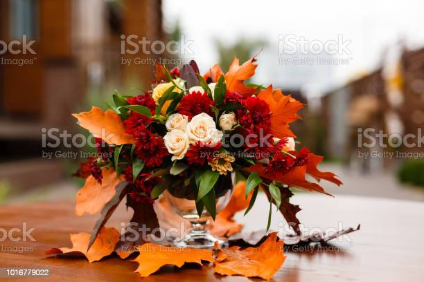 Autumn flower composition with roses chrysanthemum and maple leaves picture id1016779022?b=1&k=6&m=1016779022&s=612x612&h=toe304ctn n15wqhg2dke6rrugg952a0lgncij08nkq=