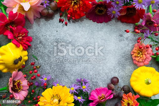 948743278 istock photo Autumn flowers frame, place for text. Top view 618869408