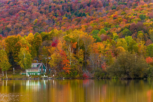 Autumn foliage and reflection in Vermont, Elmore state park stock photo