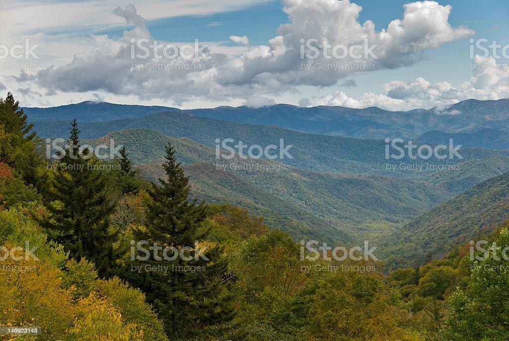 Autumn foliage of trees on the slopes in Smoky Mountains stock photo