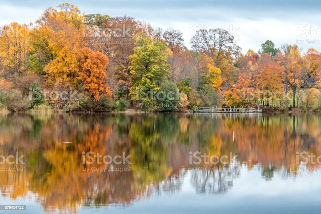 Autumn foliage reflected on the water in Bucks County, Pennsylvania stock photo