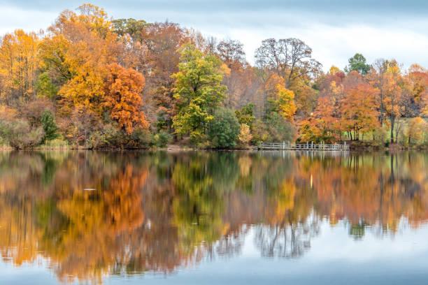 Autumn foliage reflected on the water in Bucks County, Pennsylvania stock photo