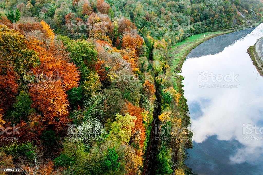 Autumn Forest with railroad by the river Autumn forest by the river Autumn Stock Photo