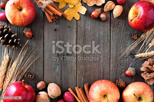 1020586746istockphoto Autumn frame of apples and fall ingredients over wood 1042074276