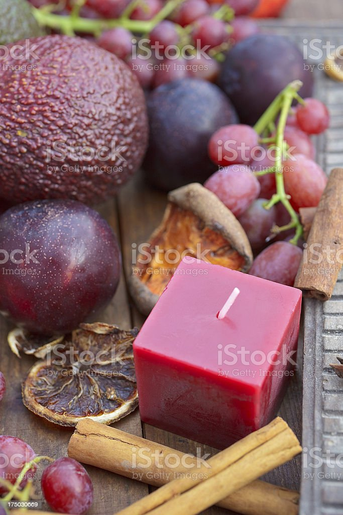 Autumn fruits and a candle royalty-free stock photo