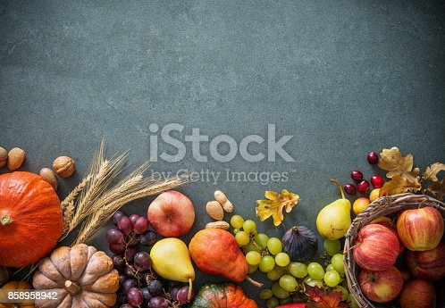 istock Autumn fruits and pumpkins with fallen leaves 858958942