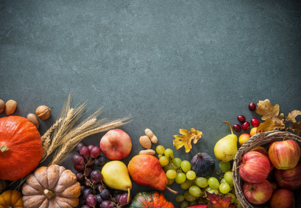 Autumn fruits and pumpkins with fallen leaves stock photo
