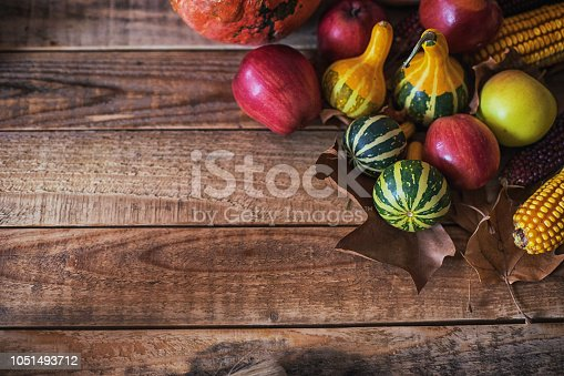 Autumn fruits background at wood board. Close up, shot from above