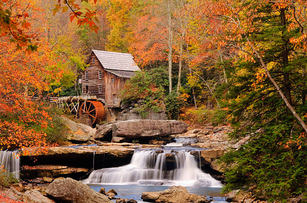 Autumn Glade Creek Mill, Babcock State Park West Virginia Autumn Glade Creek Mill, Babcock State Park West Virginia in full spectacular peak autumn colors babcock state park stock pictures, royalty-free photos & images