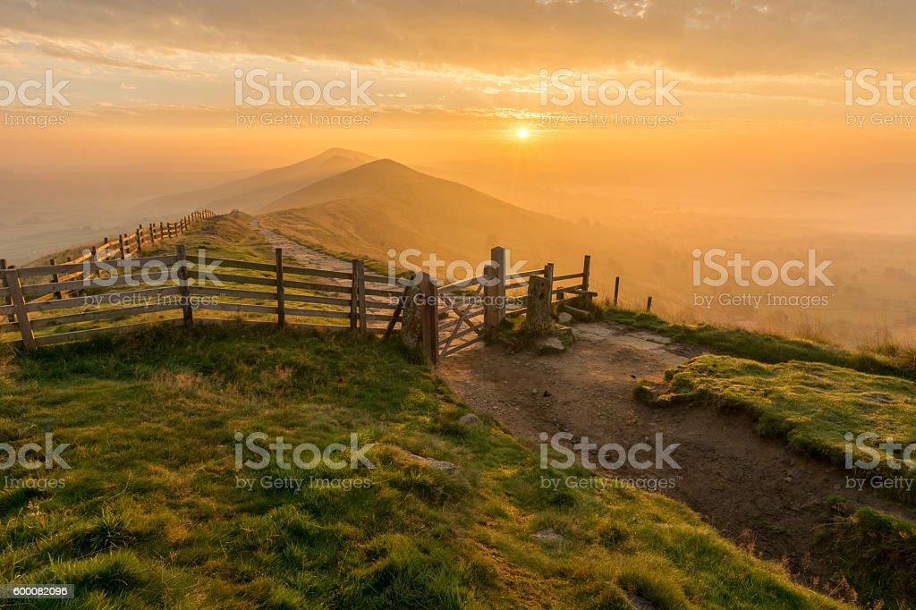 Autumn Golden Sunrise At Mam Tor In Peak District. stock photo