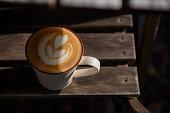Heart shape latte art in the autumn morning