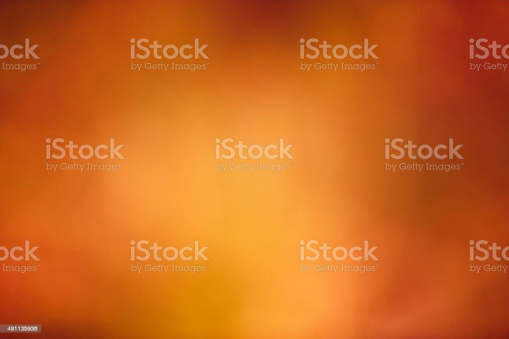 Autumn holiday bokeh background brown & orange stock photo