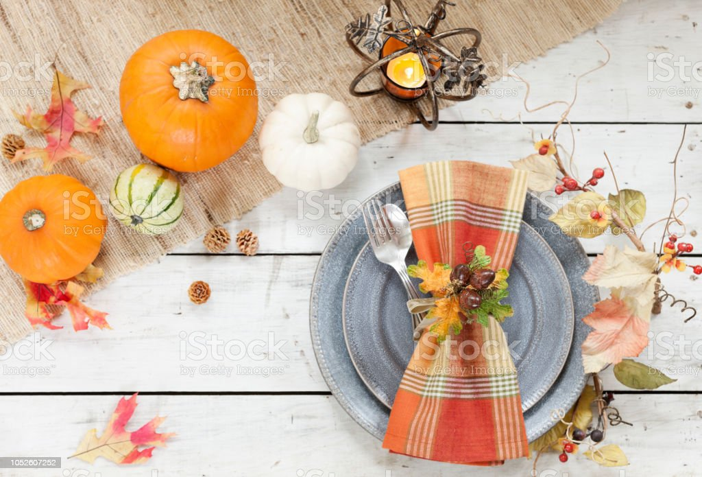 Autumn holiday Thanksgiving dining on an old wood table with...