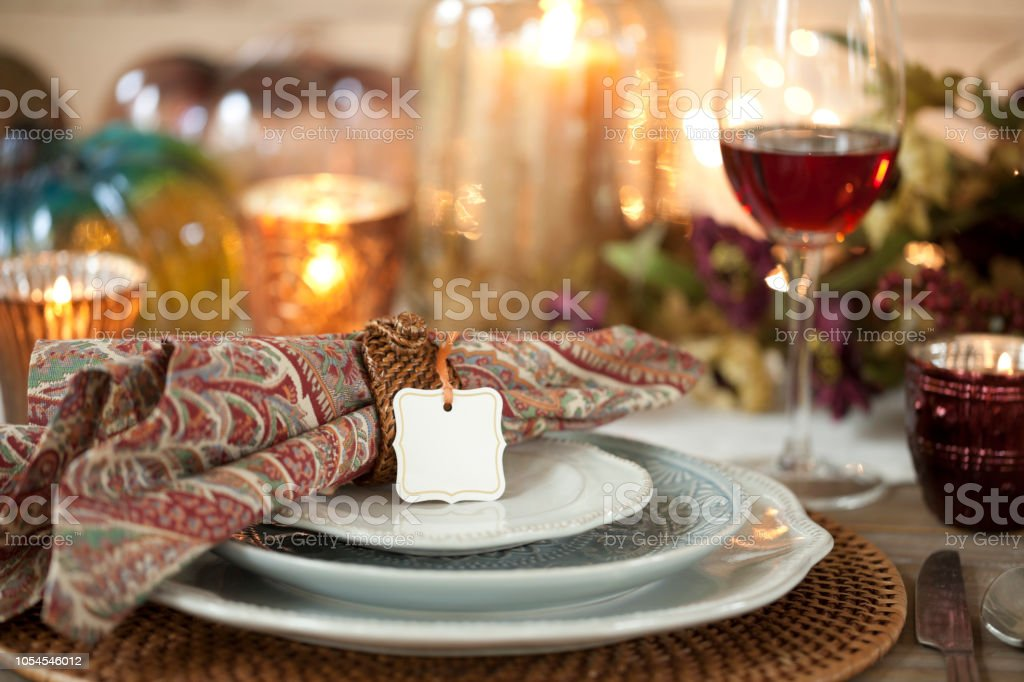 Autumn holiday Thanksgiving dining with red wine, beautiful paisley...