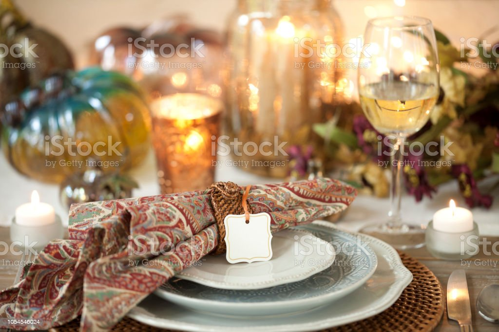 Autumn holiday Thanksgiving dining with white wine, beautiful paisley...