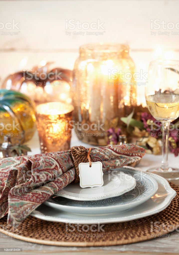 Autumn holiday Thanksgiving dining with empty place card for your...