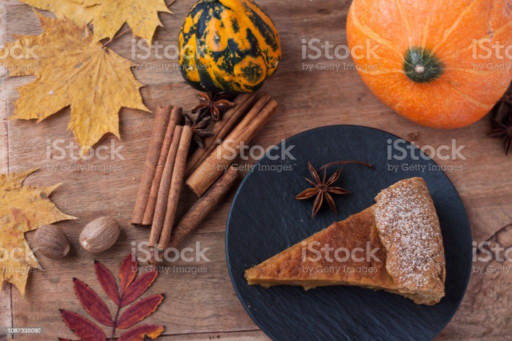 Autumn homemade pumpkin pie, pumpkin, cinnamon, anis stars stock photo