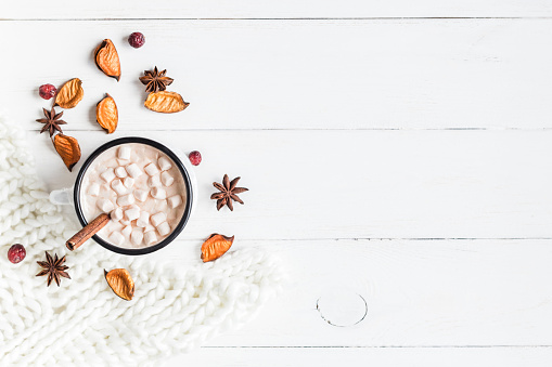 istock Autumn. Hot chocolate, knitted blanket, dried flowers and leaves 594923348