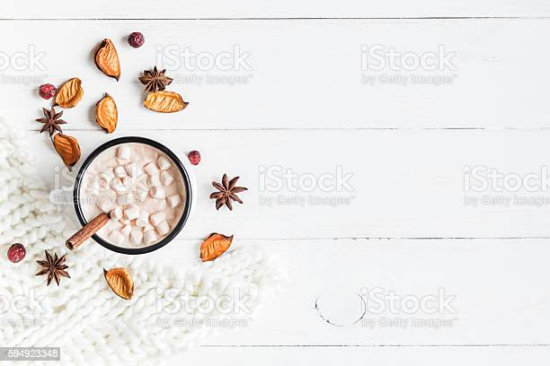 Photo of Autumn. Hot chocolate, knitted blanket, dried flowers and leaves