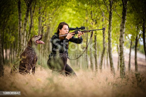 istock Autumn hunting season. Hunting. Outdoor sports. Woman hunter in the woods 1088085642