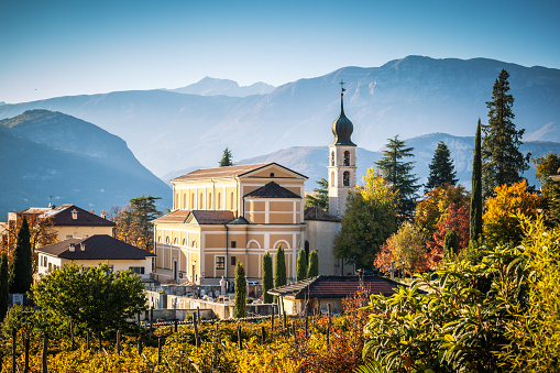 Autumn In Alps With Church In Trento Stock Photo - Download Image Now