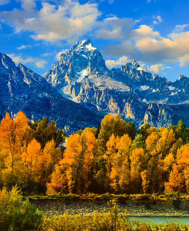 Autumn colors fill the valley below Grand Teton Peak along the Snake River, WY