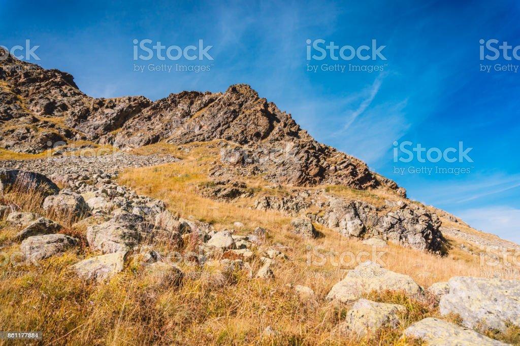 Autumn in mountains. Rocky mountains with stones. stock photo