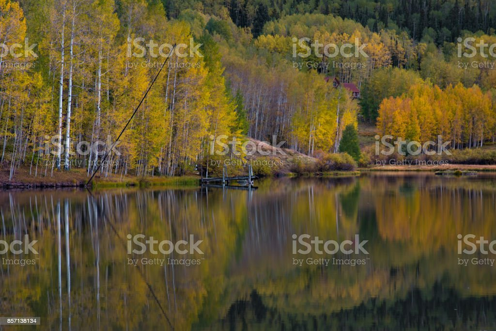 Autumn in Telluride with snow on the mountain with reflection in the lake stock photo