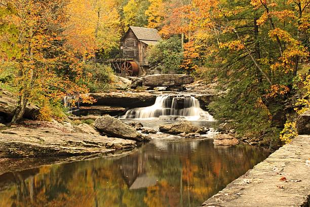 Autumn in West Virginia A long exposure shot of the Glade Creek Grist Mill in Babcock State Park (West Virginia). babcock state park stock pictures, royalty-free photos & images