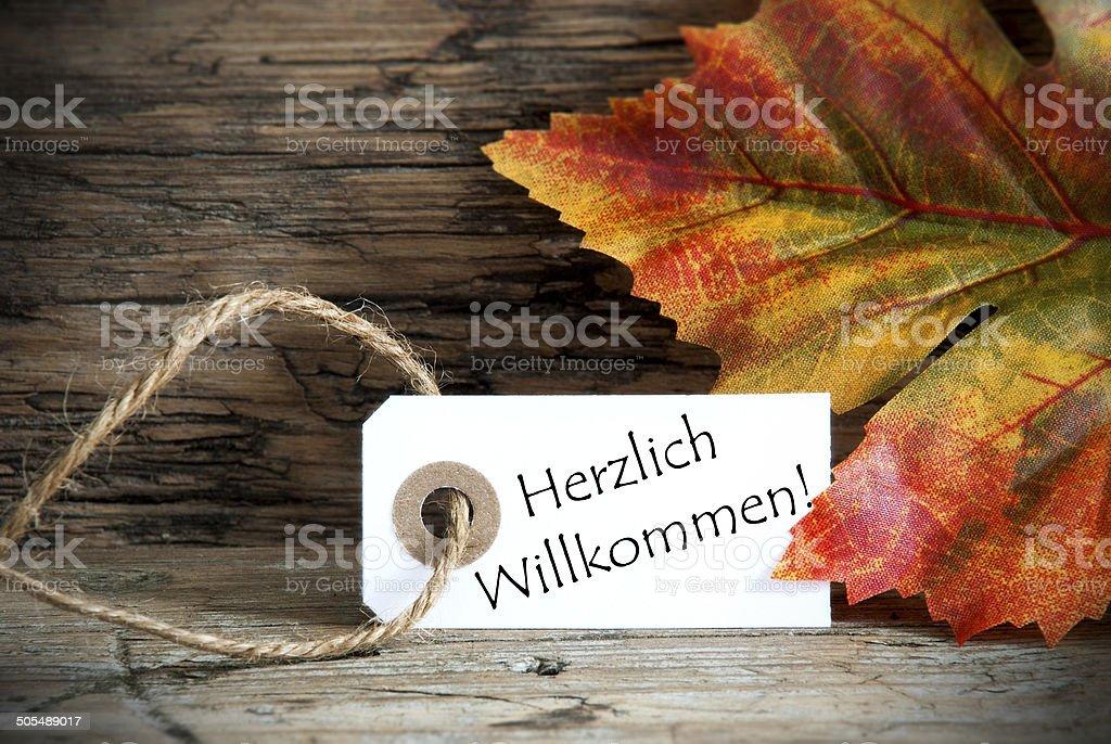 Autumn Label with Herzlich Willkommen stock photo