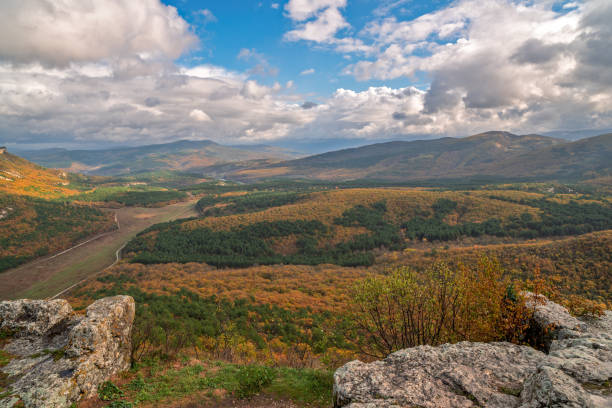 Autumn landscape of mountains and forest stock photo