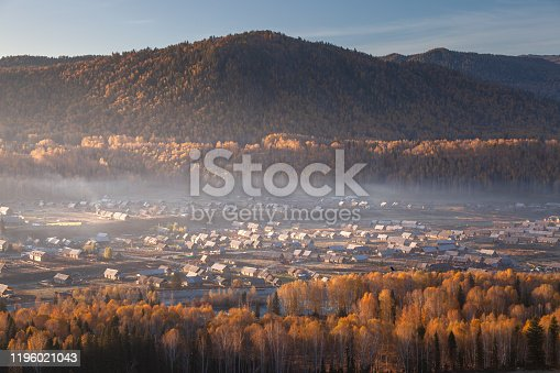 Autumn landscape of wooden houses in Hemu Village, Xinjiang, China