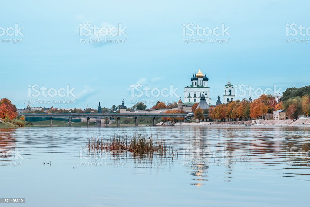 Autumn landscape, river in the background of the fortress and the Cathedral, surrounded by colorful trees stock photo