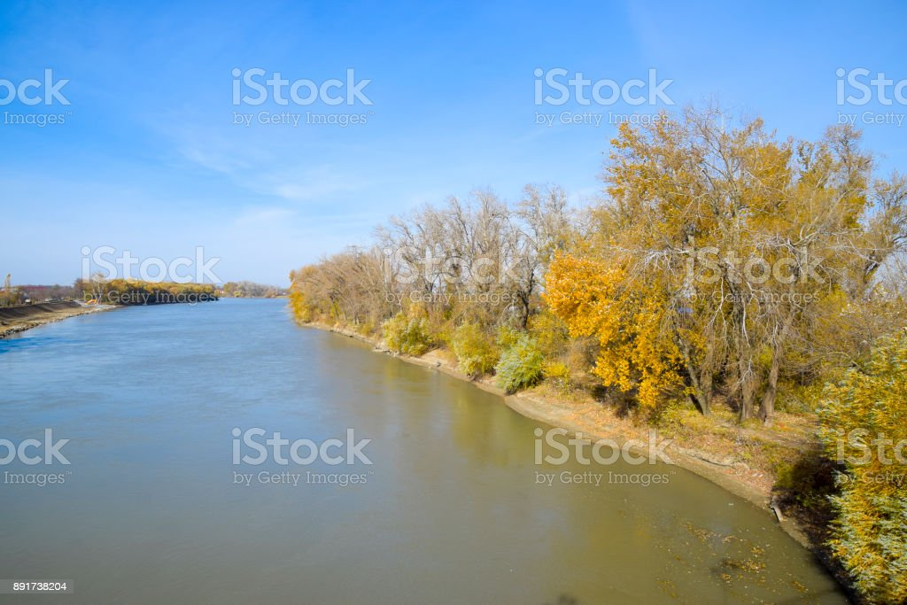 Autumn landscape. the river and the bridge type. Trees with yell stock photo