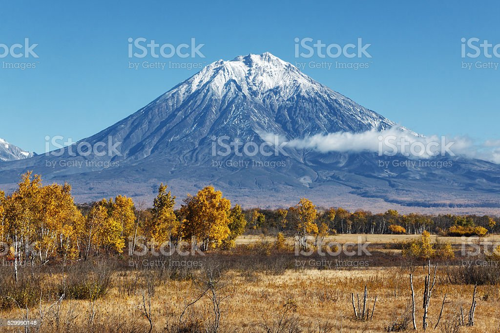 Autumn landscape: volcano and blue sky on clear sunny day stock photo