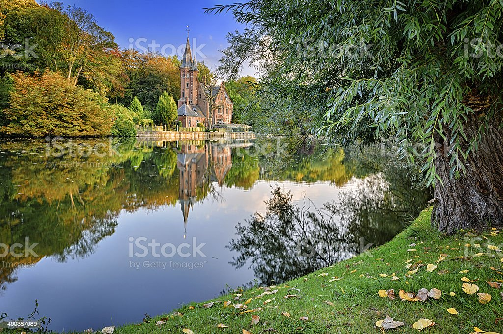 Autumn landscape with lake and old mansion stock photo