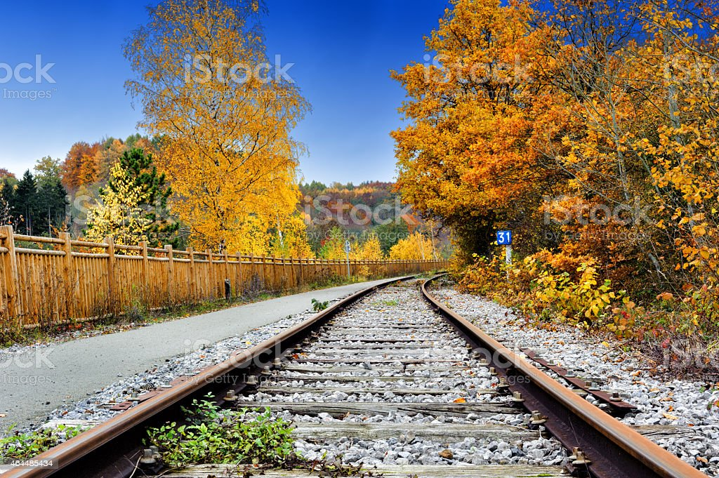 Autumn landscape with railway track stock photo