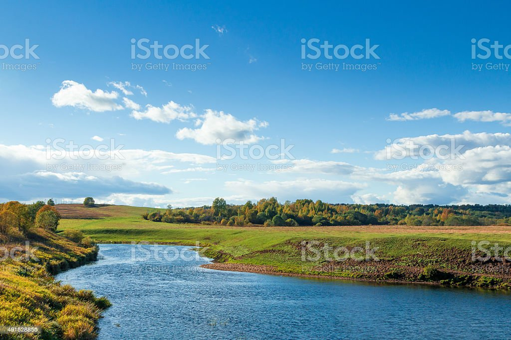 Autumn landscape with river on foreground. stock photo