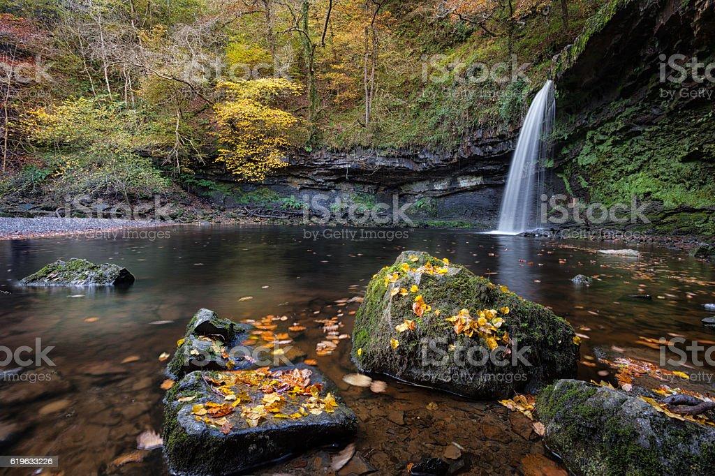 Autumn leaves at Sgwd Gwladus stock photo