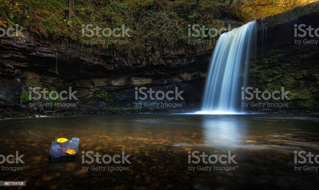 Autumn leaves at Sgwd Gwladus waterfall stock photo
