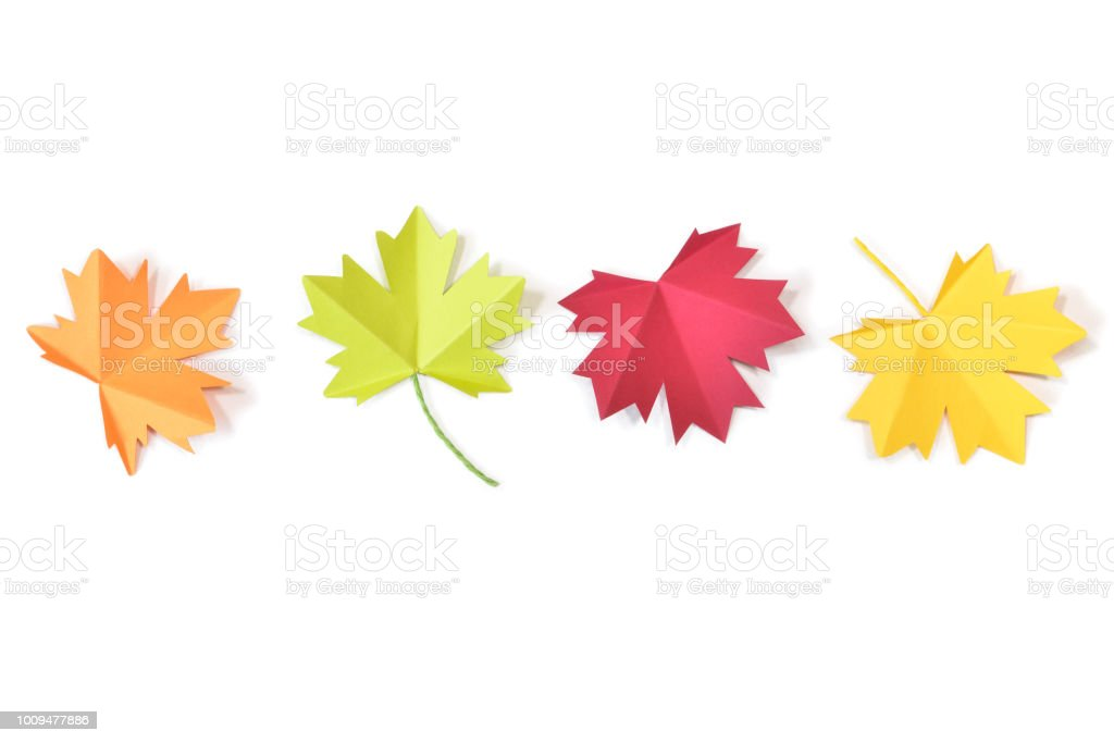 Autumn leaves paper cut on white background stock photo