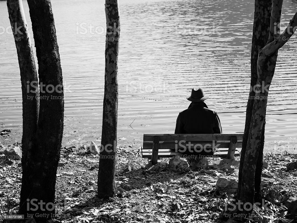 Autumn loneliness by lake,melancholic atmospehere of autumn, adult...